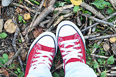 istock red shoes on the grass 1048577066