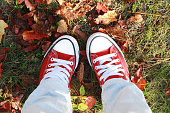 istock red shoes on the grass 1048584472