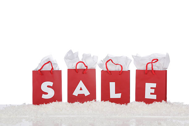 Red shopping bags that spell out the word sale stock photo