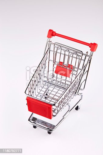 642250754 istock photo Red shopping cart isolated on white background 1180752771