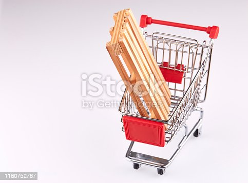 642250754 istock photo Red shopping cart with pallet isolated on white background 1180752787