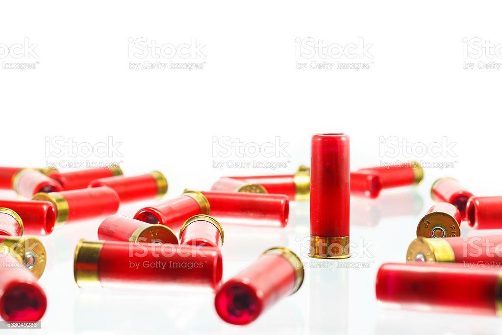 red shotgun shell bullet on a white background. stock photo