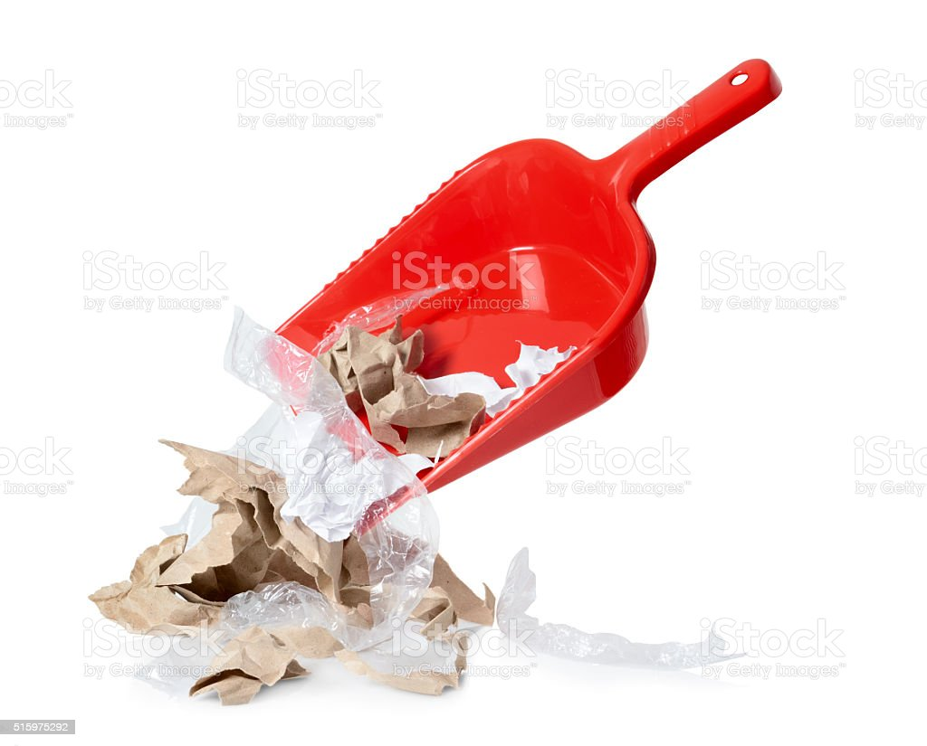 Red shovel with litter isolated on white background stock photo