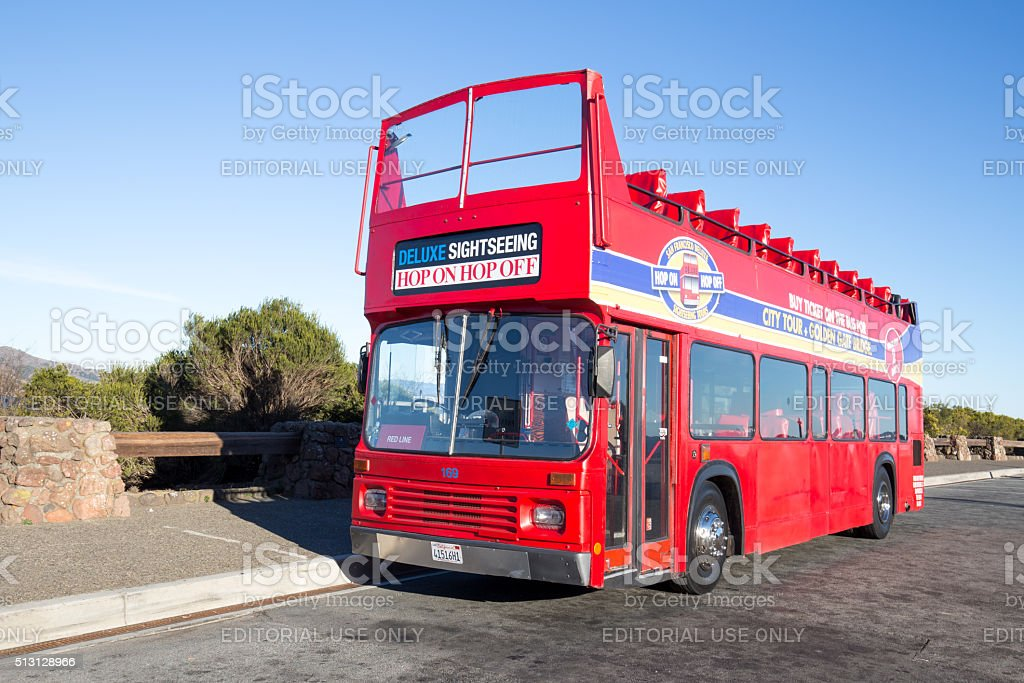 red sightseeing bus on road stock photo