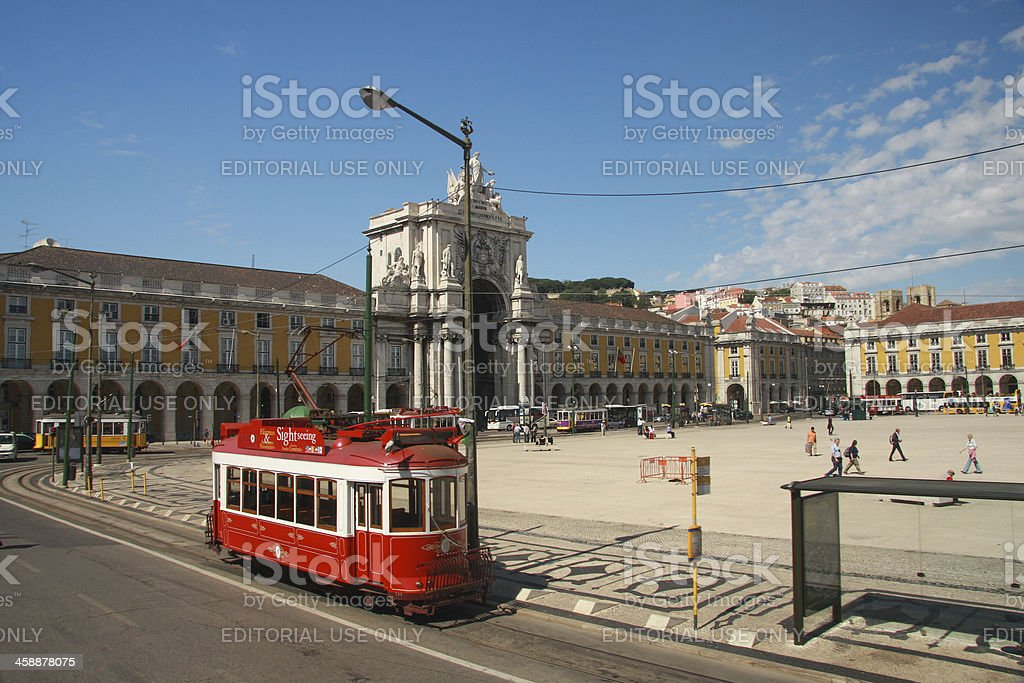 Red sightseeing tram starts from downtown Commerce square Lisbon royalty-free stock photo
