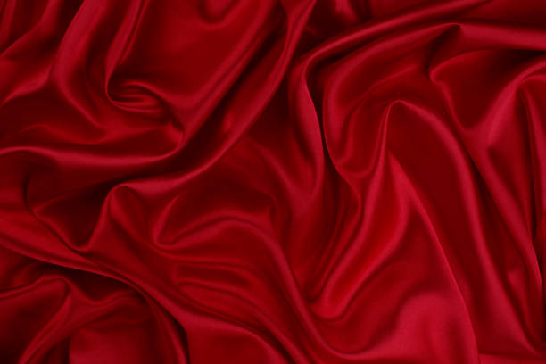 red silk fabric background - velvet stock pictures, royalty-free photos & images