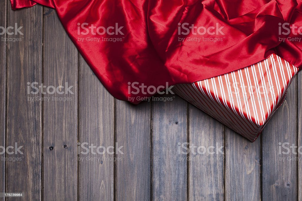 red silk on wooden background royalty-free stock photo