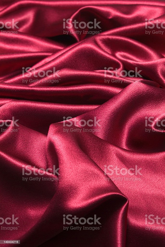 Red silky fabric background stock photo