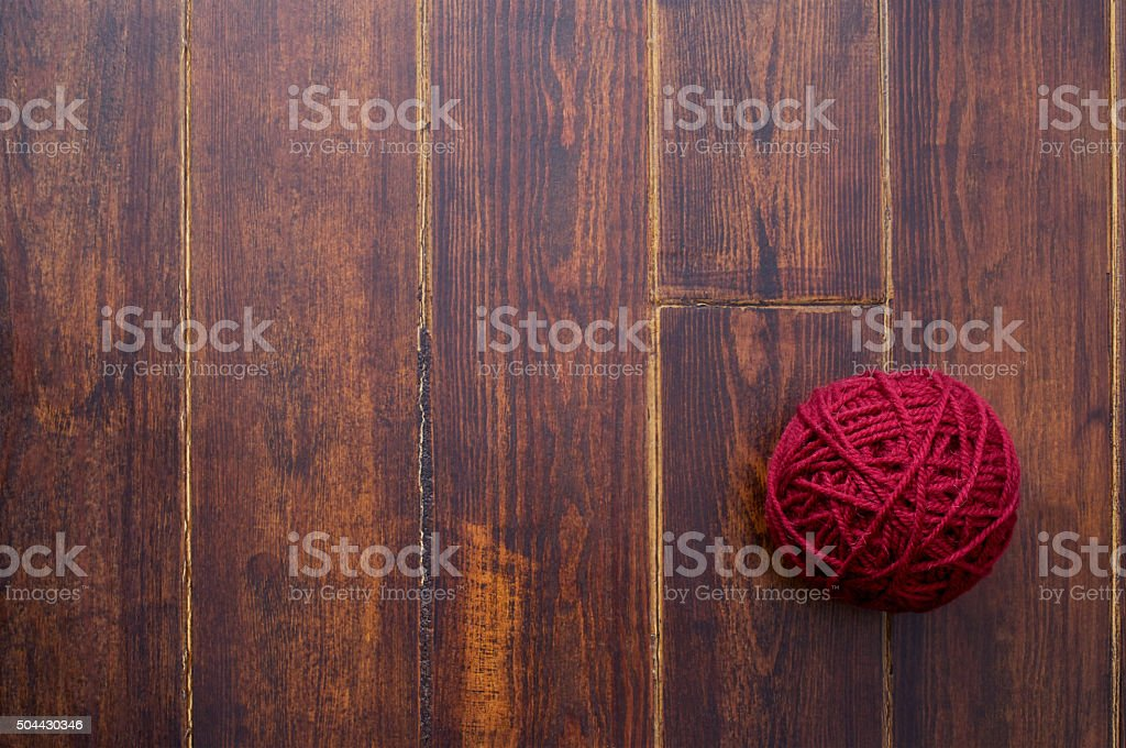 Red skein over wooden background stock photo