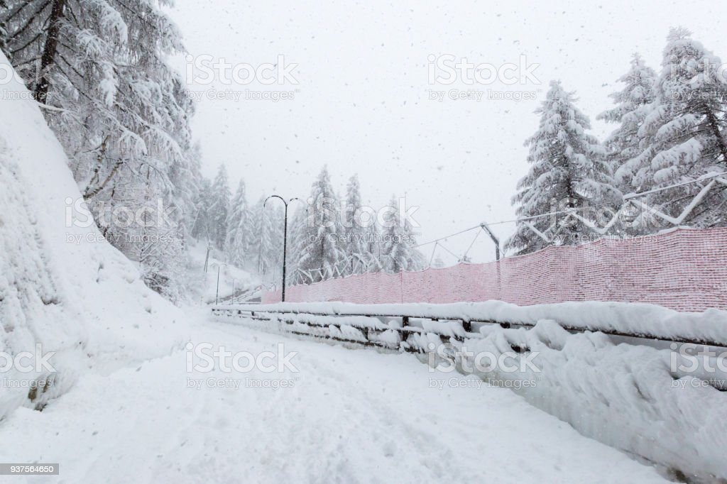 A red ski run makes it way back into Zermatt village stock photo