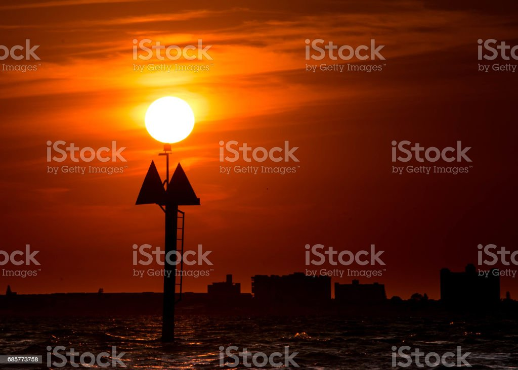 Red sky sunset boat marker beach sign royalty-free stock photo