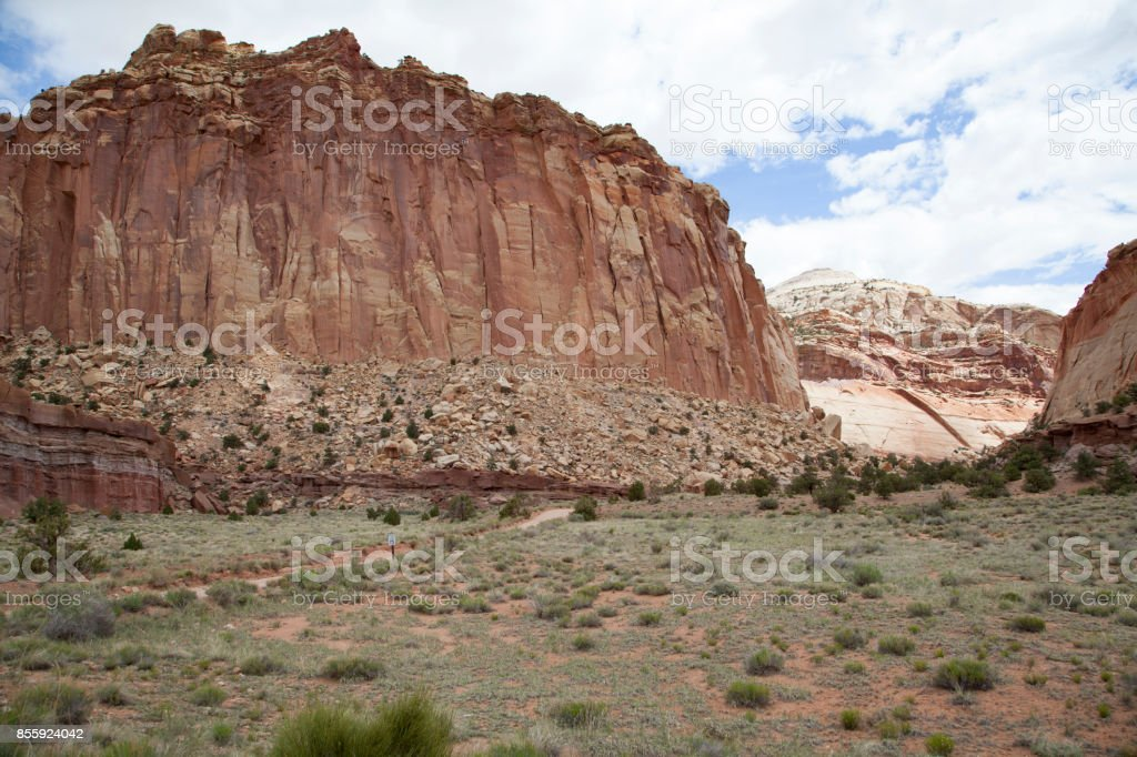 Red slick rock canyons and mesa abound in the beautiful landscape of Capitol Reef National Park in Utah stock photo