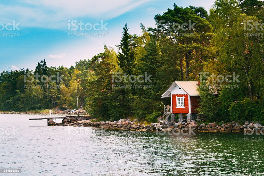 Red Small Finnish Wooden Sauna Log Cabin  Island Autumn Season stock photo