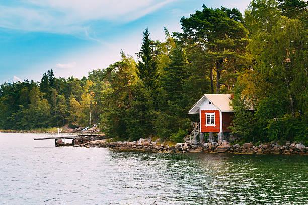 red small finnish wooden sauna log cabin  island autumn season - kır evi stok fotoğraflar ve resimler