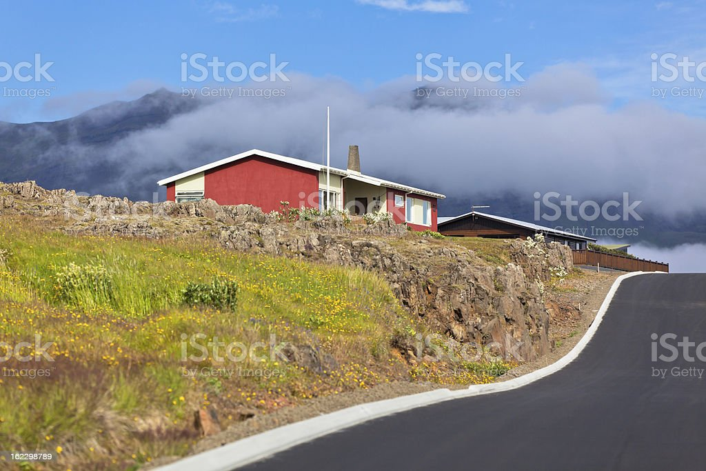 Red Small House and New Asphalt Road in East Iceland royalty-free stock photo