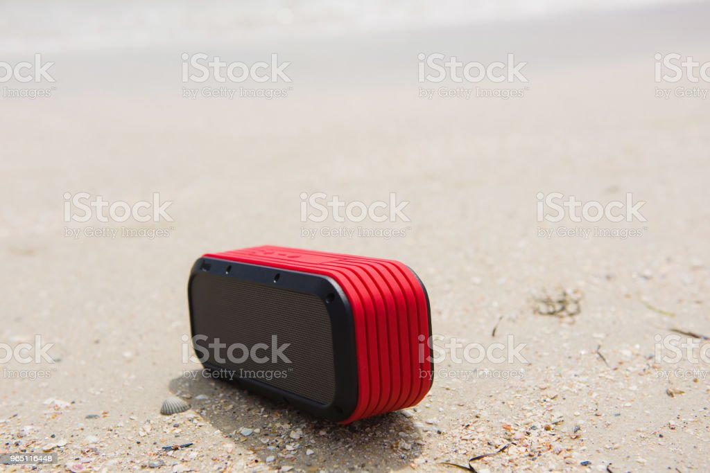 Red small portable speaker outdoors royalty-free stock photo