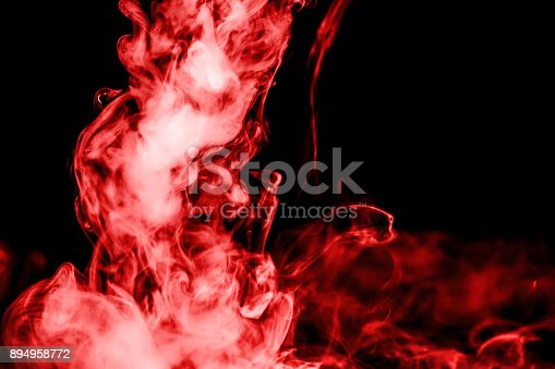 874895030istockphoto red smoke isolated on a black background. fractal. spiral. 894958772