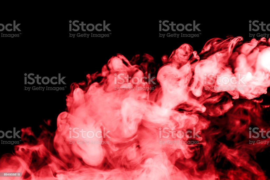 red smoke isolated on a black background. fractal. spiral. stock photo