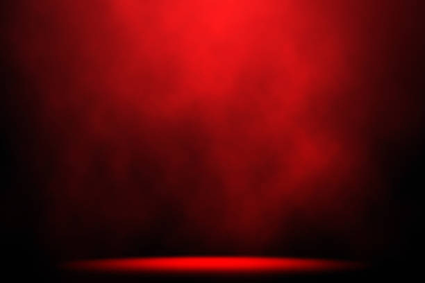 Red smoke spotlight on stage background. stock photo
