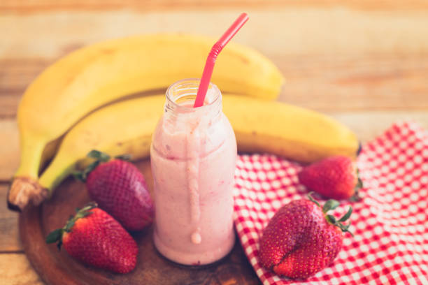Red smoothie in small bottle stock photo