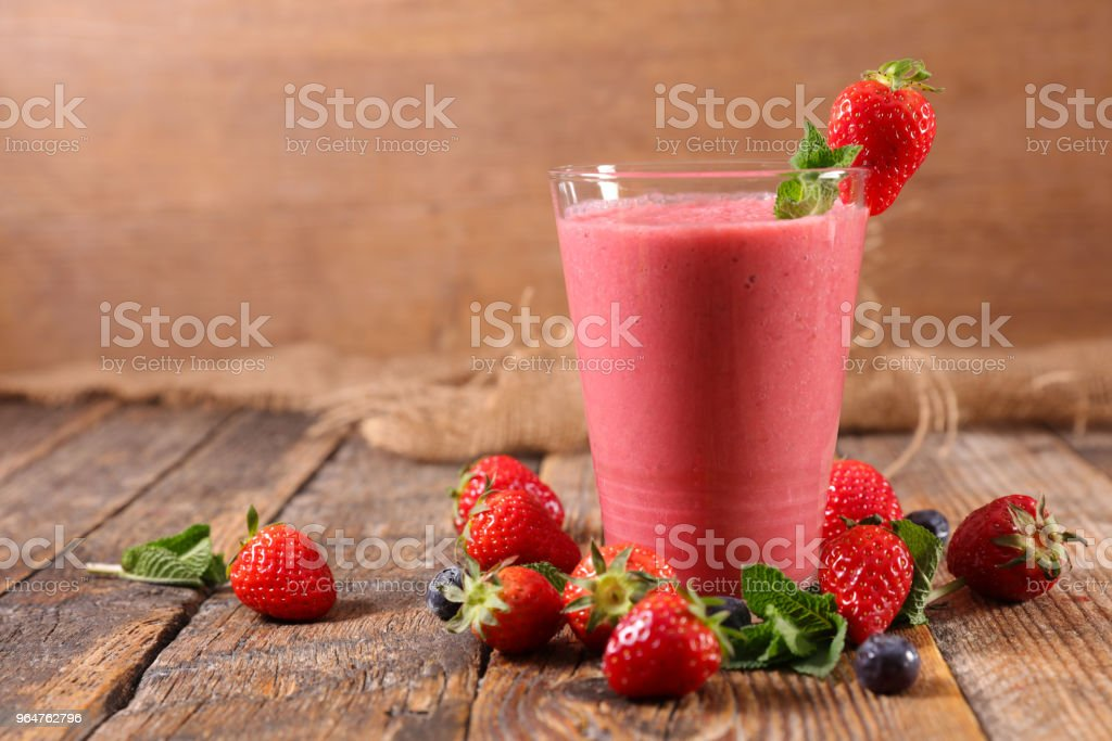 red smoothie on wood background royalty-free stock photo
