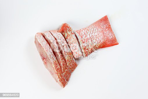 Cleaned descaled sliced red snapper fish fillet pieces on white background