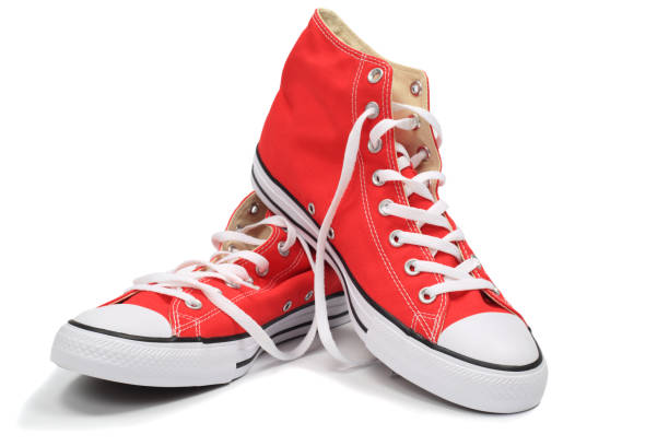red sneakers - shoe stock photos and pictures