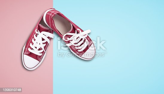 Red sneakers top view close up isolated on white background
