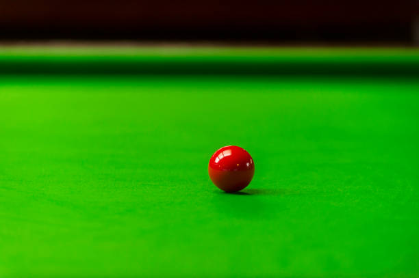 Red snooker ball on green table background stock photo