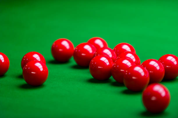 Red snooker balls on snooker table stock photo