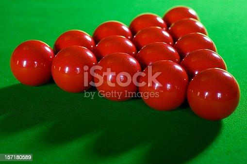 Red balls set up on felt, ready for the break.