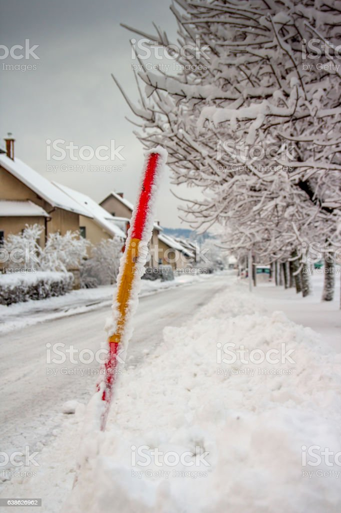Red snow stake stock photo