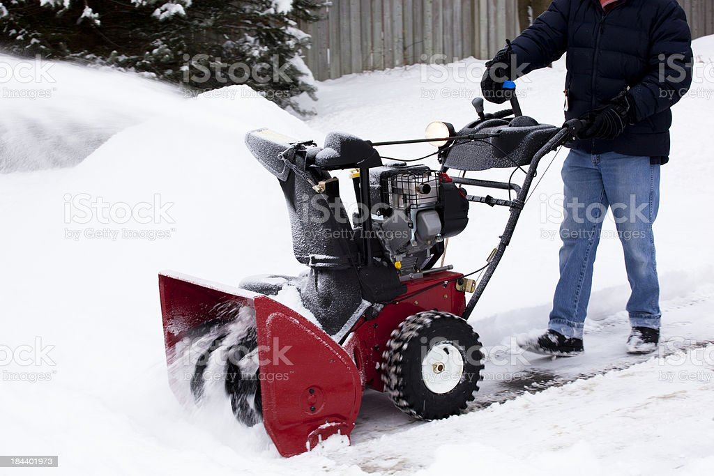 Red Snowblower Clearing Laneway stock photo