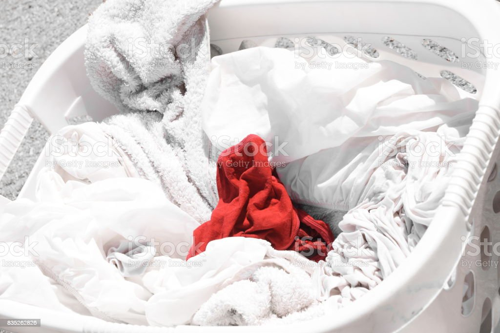 A red sock in a  White laundry stock photo