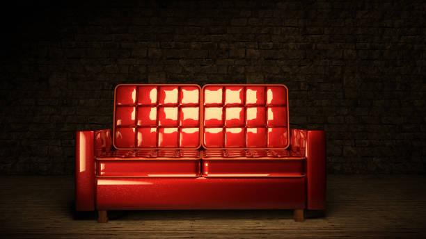 rotes sofa im dunklen raum - club sofa stock-fotos und bilder