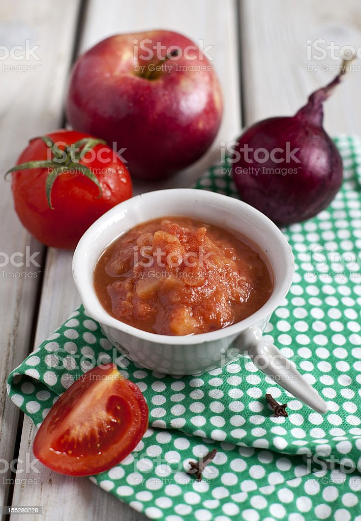 Red spicy sauce with apples and tomatoes royalty-free stock photo