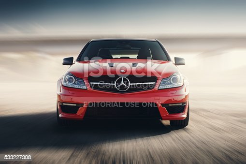 Saratov, Russia - August 24, 2014: Mercedes-Benz C63 AMG car drive on road at sunset