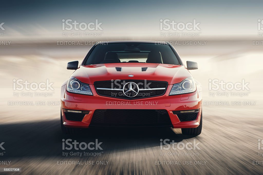 Red Sport Car Drive Speed On Asphalt Road At Sunset stock photo
