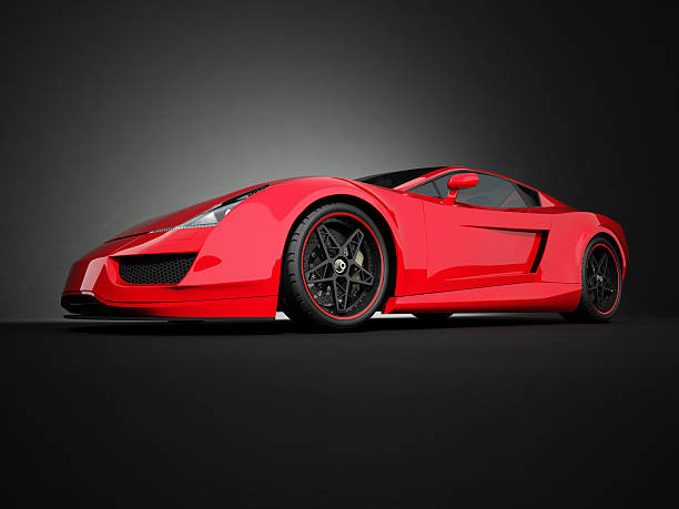Red sport car on black studio background stock photo