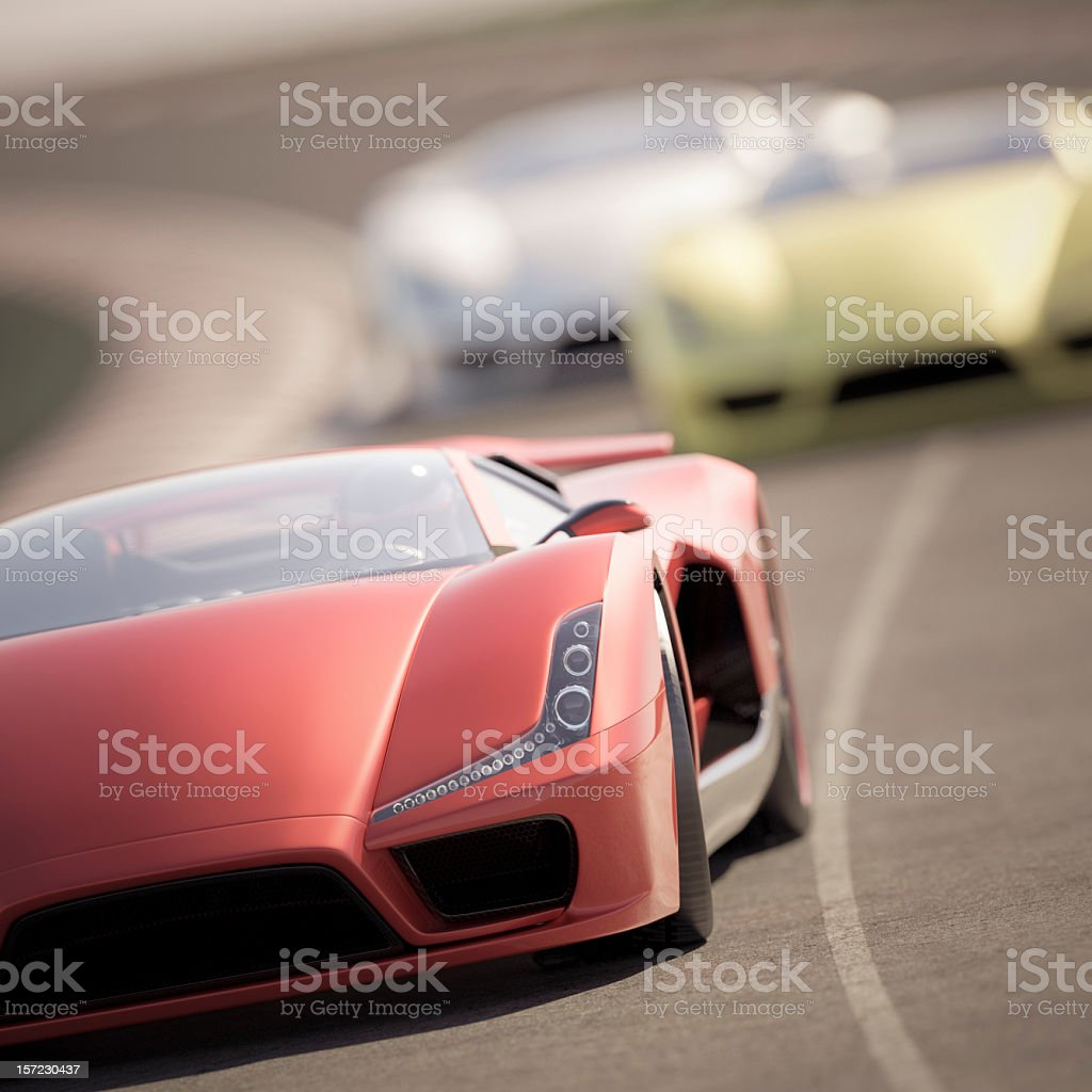 Red sports car ahead of green and white cars on a track stock photo