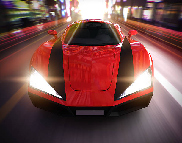 Red sports car driving fast in urban environment stock photo
