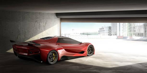 red sports car in open door garage on bright day - consumo exibicionista imagens e fotografias de stock