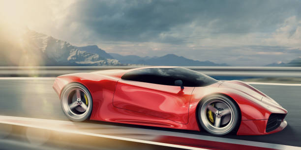 Red Sports Car Moving Fast On Racetrack At Sunset A side view of a generic red sports car travelling at speed with motion blur on wheels. The car is being driven fast on a road on a high altitude outdoor racetrack close to mountains in the background, under a overcast, cloudy evening sky at sunset. status symbol stock pictures, royalty-free photos & images