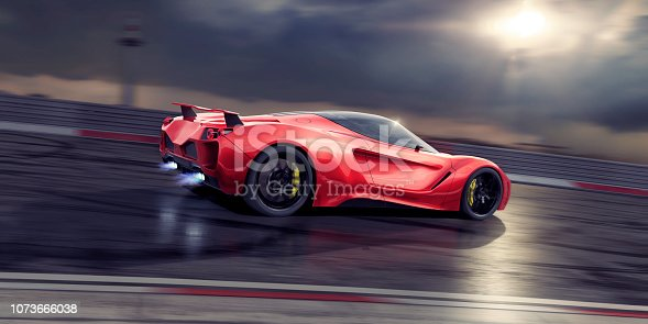 Side view of a generic red sports car traveling at high speed on a racetrack with blue flames coming from exhaust pipes. The supercar is moving fast under and stormy evening sky with sunlight coming through the clouds. With motion blur on background and foreground and wheels.