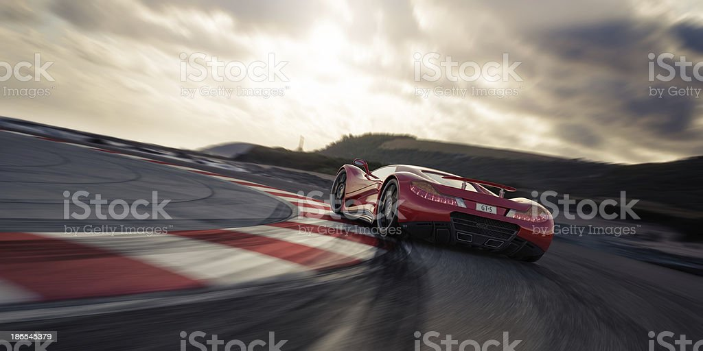 Red Sports Car on a Racetrack stock photo