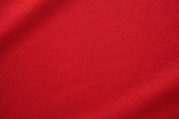Red sports clothing fabric football jersey texture close up Red sports clothing fabric football jersey texture close up red cloth stock pictures, royalty-free photos & images