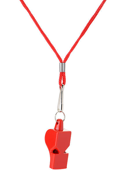 Red sports whistle on a red string on a white background stock photo