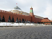 Kremlin wall, Putin residence, Lenin mausoleum and snow covered pines in russian winter