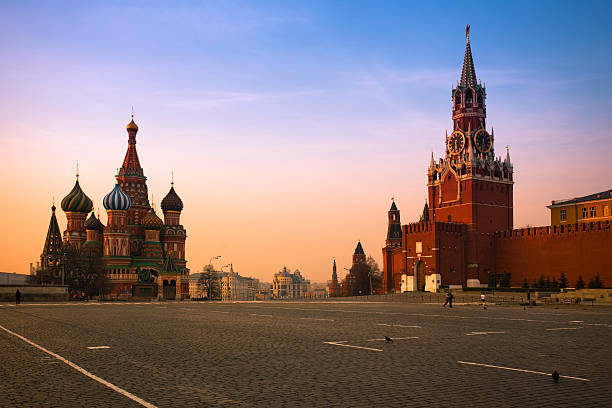 Red Square in Moscow at Sunrise Red Square is the most famous city square in Moscow, and arguably one of the most famous in the world. The square separates the Kremlin, the former royal citadel and currently the official residence of the President of Russia, from a historic merchant quarter known as Kitai-gorod. As major streets of Moscow radiate from here in all directions, being promoted to major highways outside the city, Red Square is often considered the central square of Moscow and of all Russia. moscow russia stock pictures, royalty-free photos & images