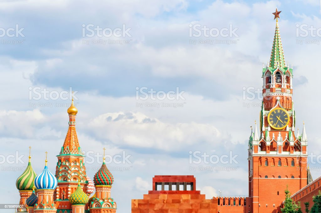 Red square, Moscow, Russia. Spasskaya tower of Kremlin, Lenin's Mausoleum and st. Basil Cathedral. Sparse composition with copy space on the cloudy sky stock photo